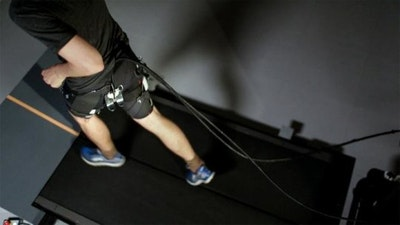 Tethered soft exosuit reduces metabolic cost of running