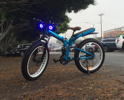 An on/off-road, full-suspension electric folding bike