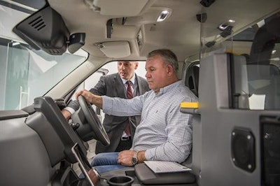 First new TX eCITY London taxi handed over to London cabbie