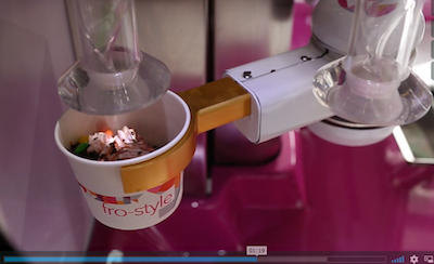 Frozen yoghurt robots, eliminates need for staff