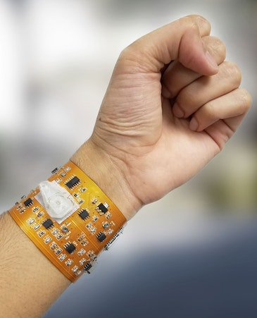 Smart wristband with wireless link monitors health, environment