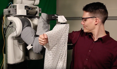 Robot teaches itself how to dress people