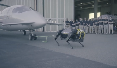 Quadruped robot tested by pulling 3 tonne airplane