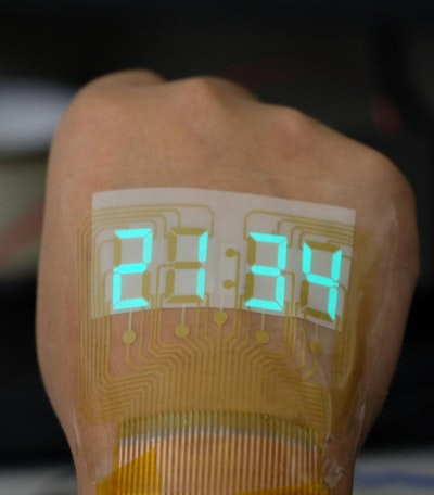 A Stretchable Stopwatch Lights Up Human Skin